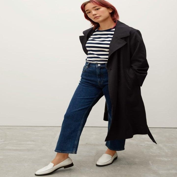 model wearing the calf-length coat open