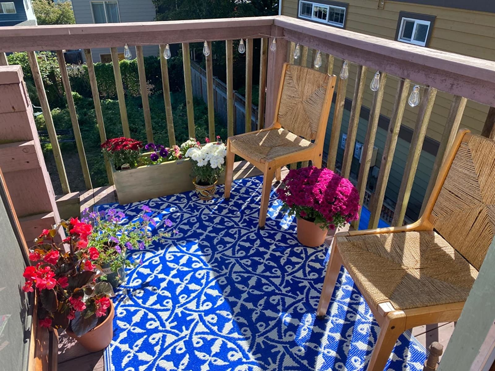 blue and white patterned rug on reviewer's balcony