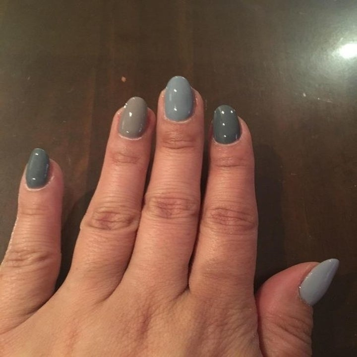 Reviewer showing off shiny nails after using top and base coat