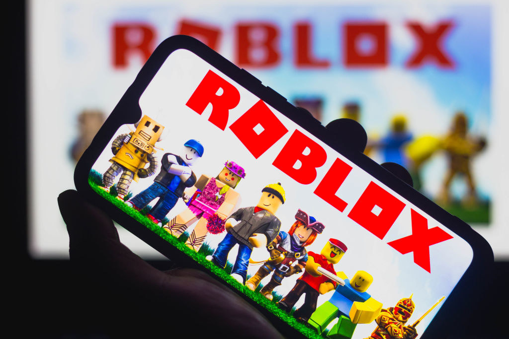 phone with Roblox screen on it