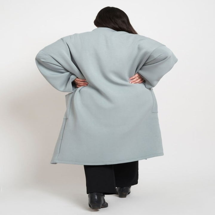 the back view of the coat on the model