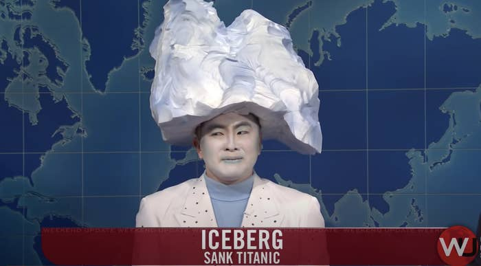 Bowen dressed in a white suit and blue turtleneck with white face makeup and iceberg headpiece