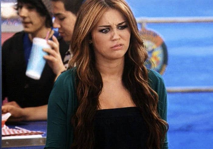 Miley Cyrus makes a disgusted expression in an episode of Hannah Montana