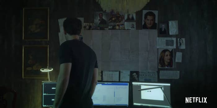 A wall full of photos and notes in Who Killed Sara?