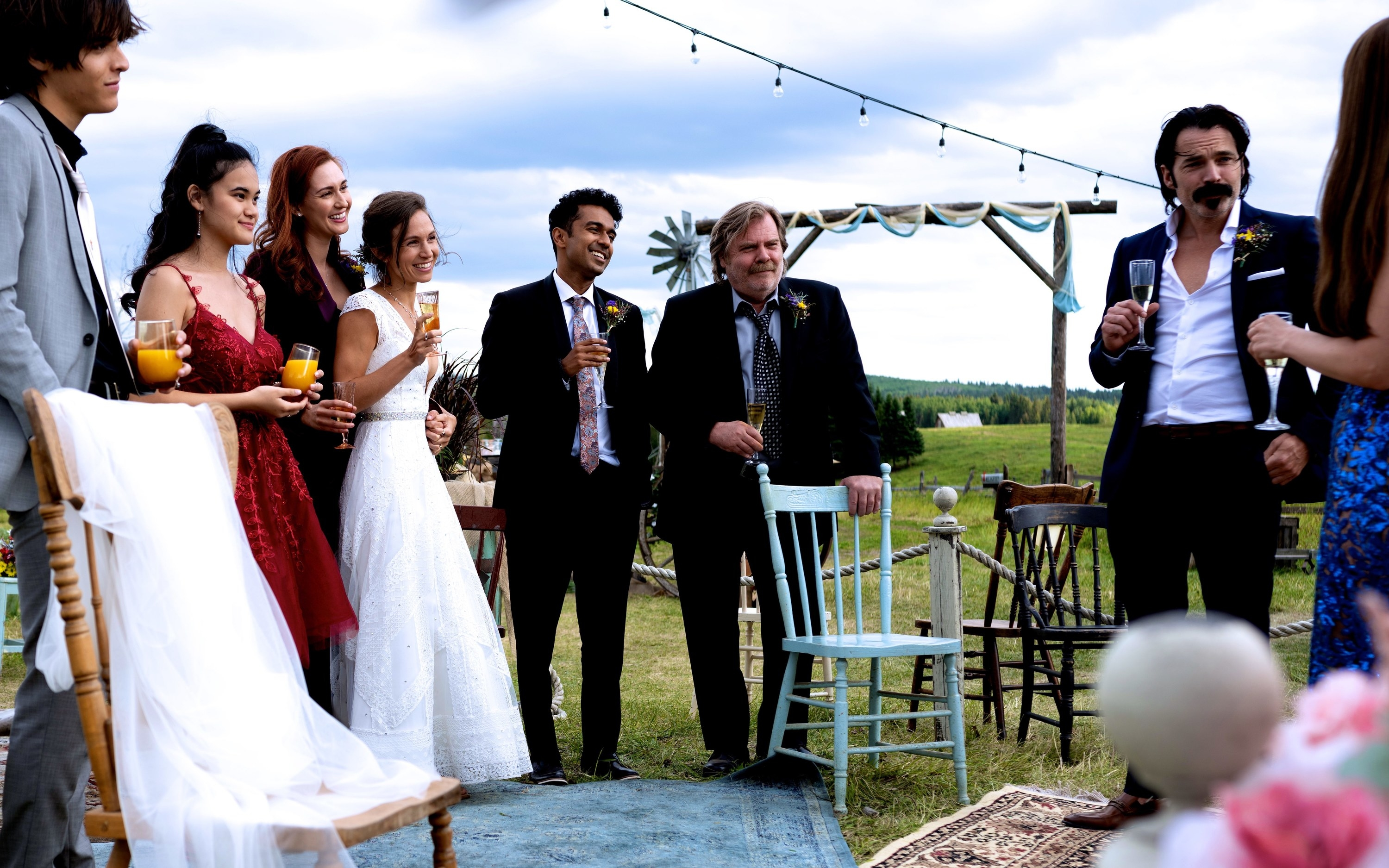 "The cast of ""Wynonna Earp"" at Waverly and Nicole's wedding"
