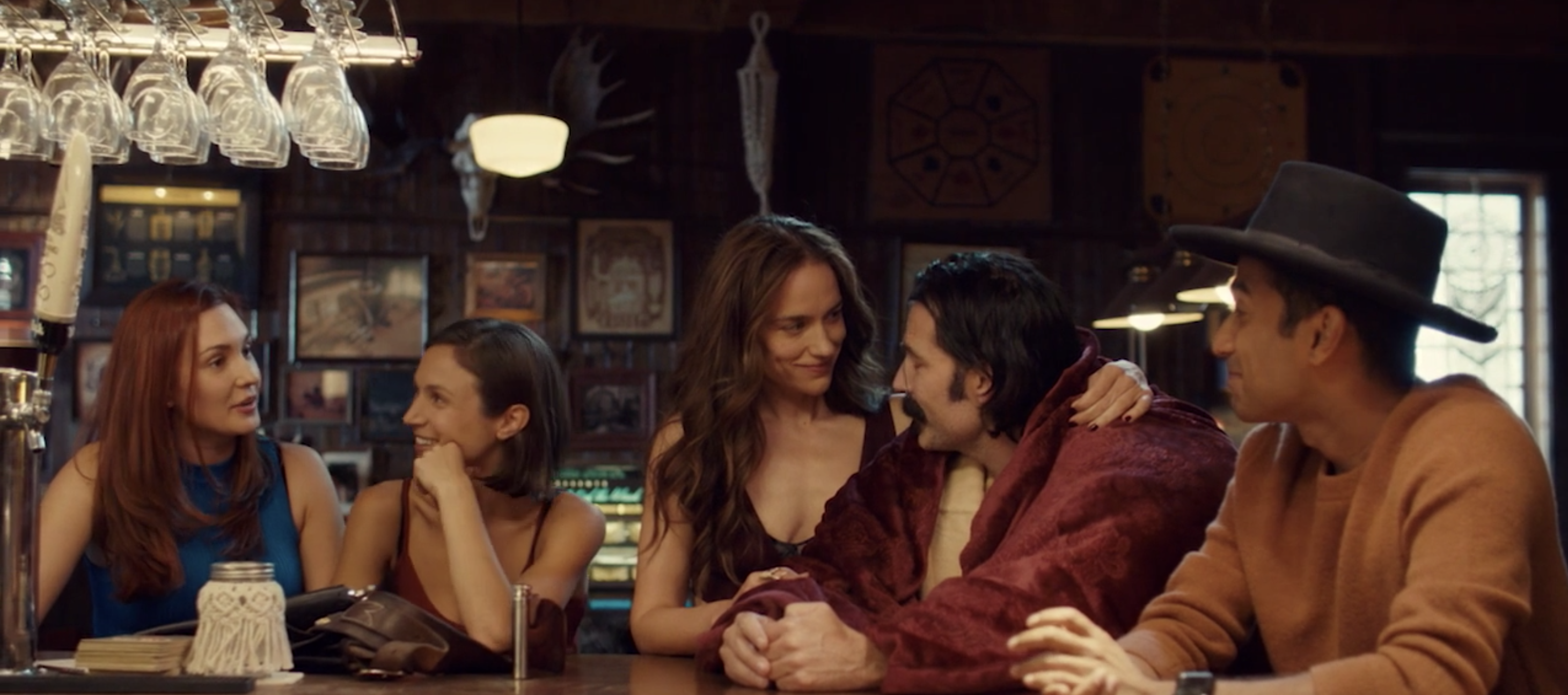"The cast of ""Wynonna Earp"" sitting at Shorty's bar"