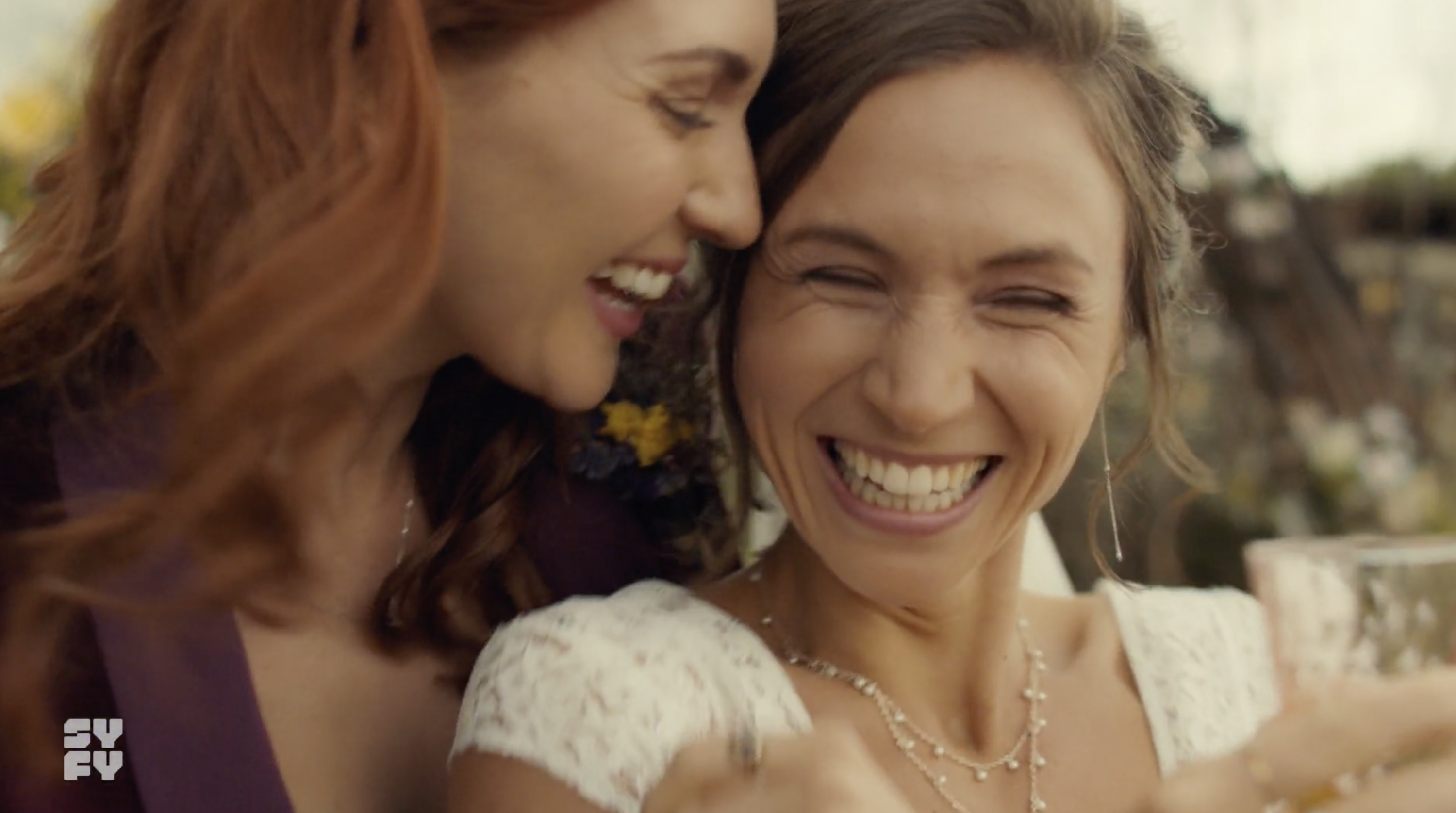 Waverly and Nicole smiling and laughing during their wedding
