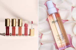 Four tubes of lip oil in a row, A bottle of body oil lying a surface covered in petals