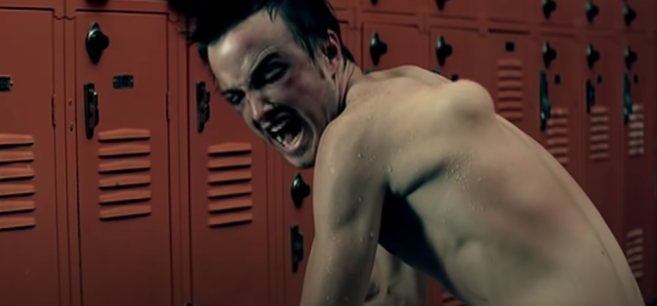 aaron paul with a large bump on his back