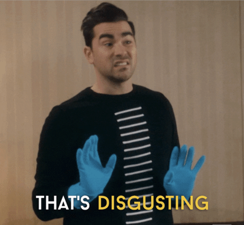"""David Rose wearing rubber gloves and saying """"that's disgusting"""""""