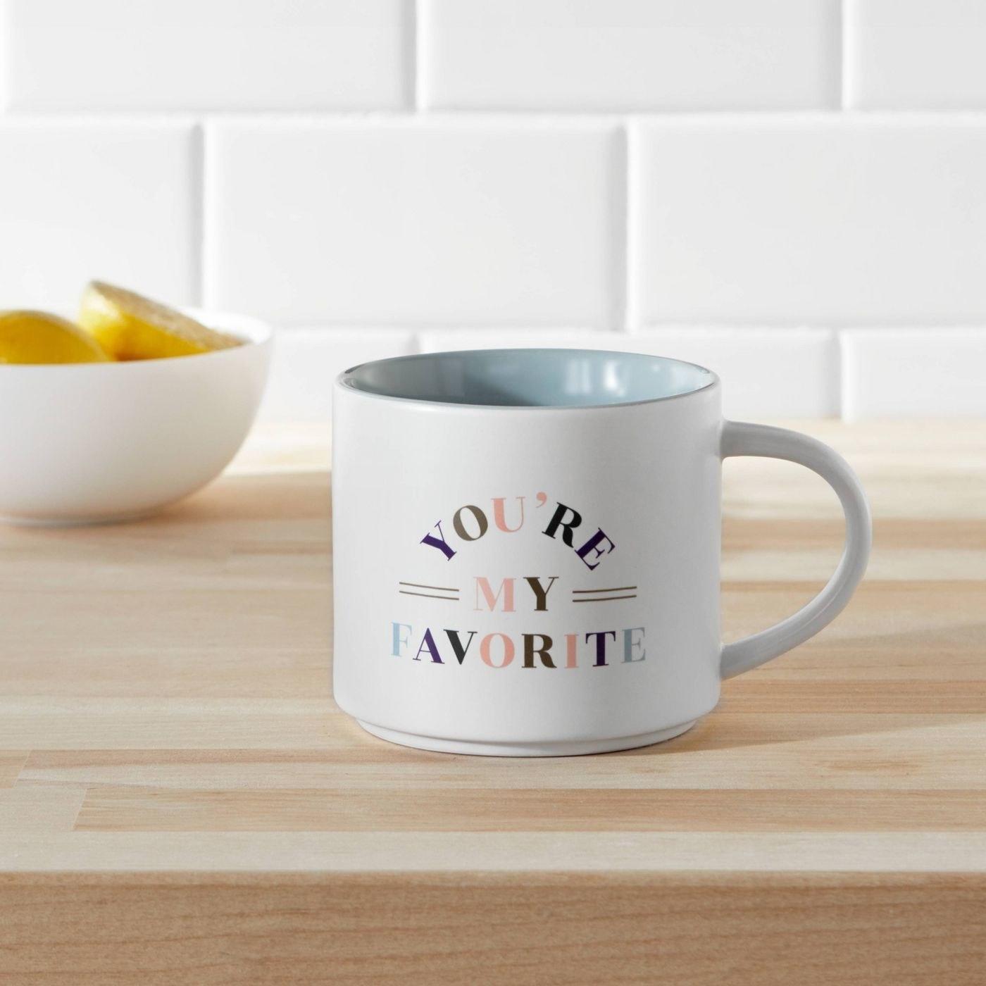 White and rainbow mug with pale blue inside