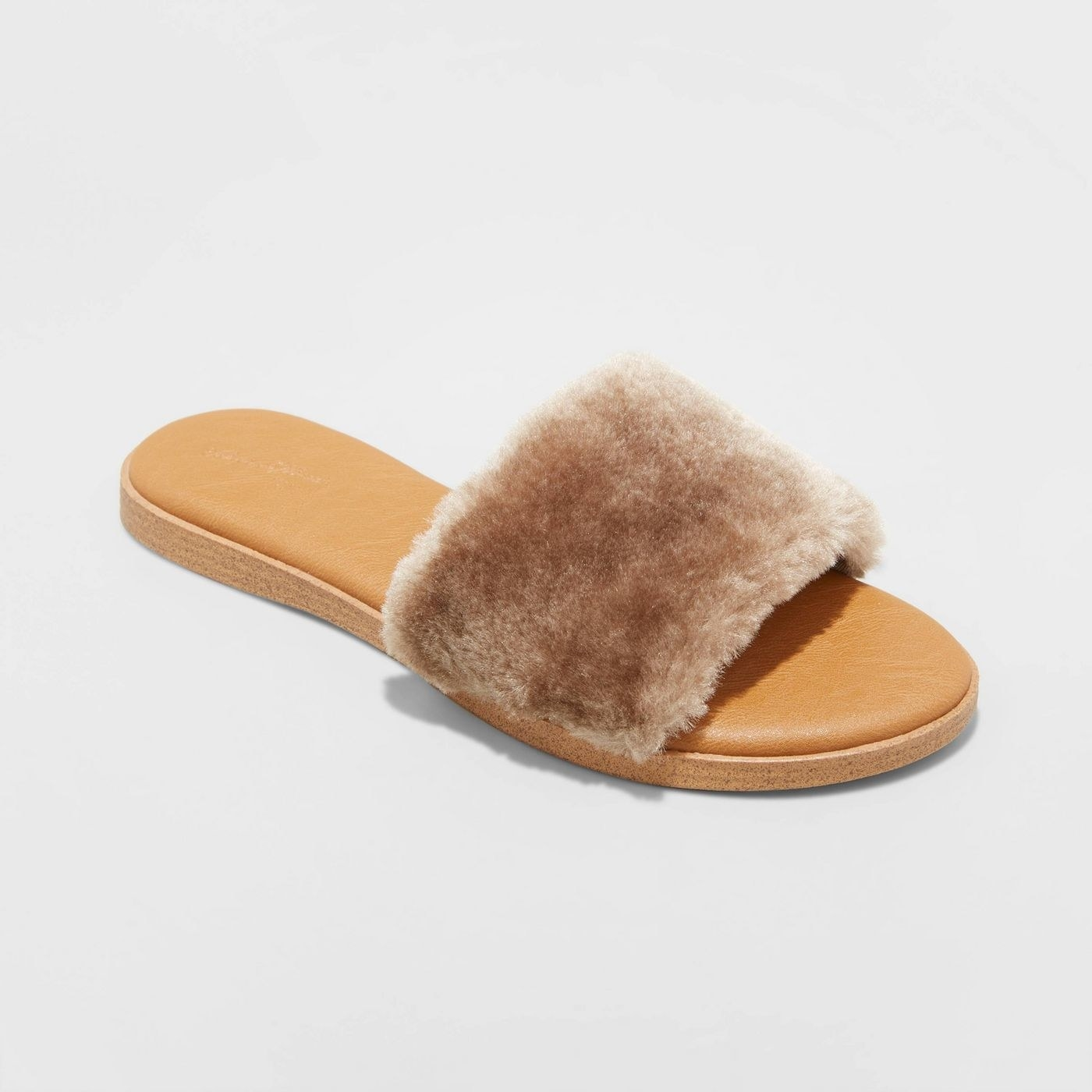 Sandals with tan fur and tan padded sole