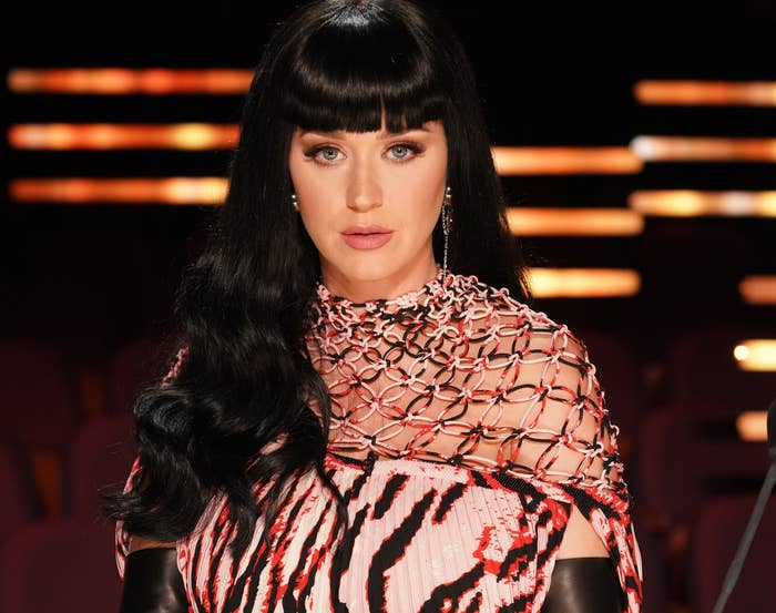 Katy shows off black hair and bangs on set