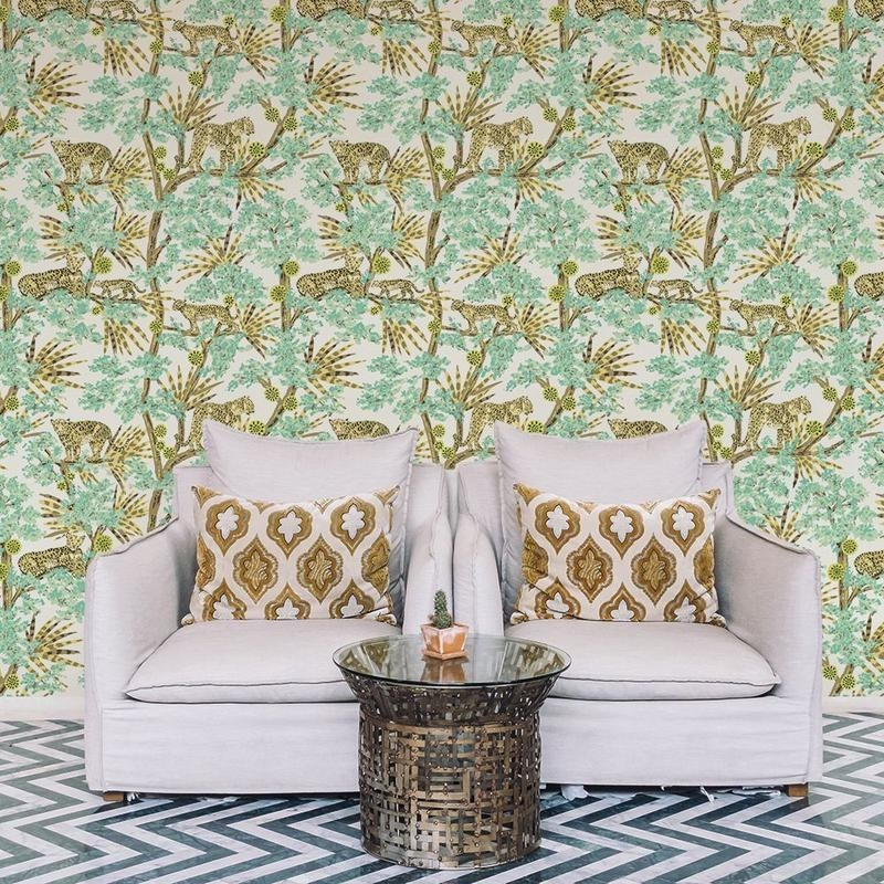 a patterned green wallpaper with leaves and leopards all over it