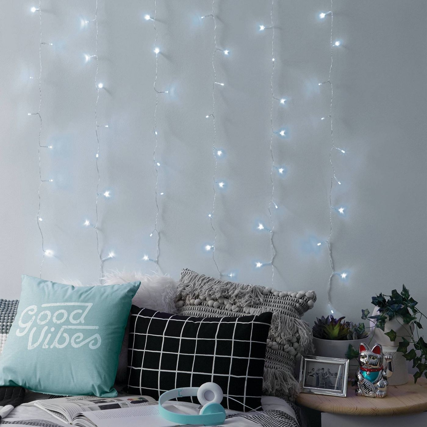 Cool white/blue lights in gray and blue bedroom