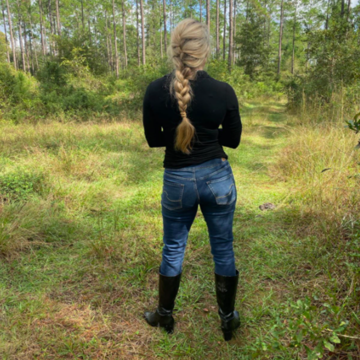 A customer review photo showing the back of the jeans