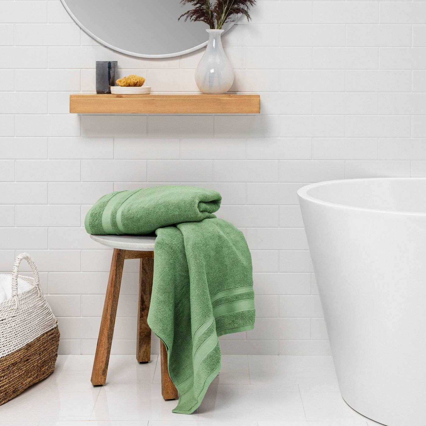 Green towels in a white bathroom