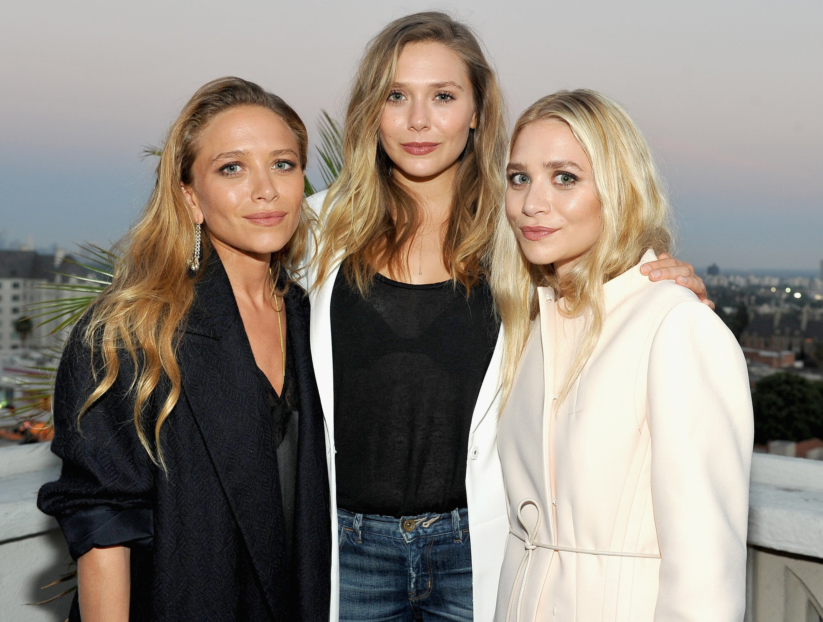 Elizabeth poses with her sisters Mary Kate and Ashley recently