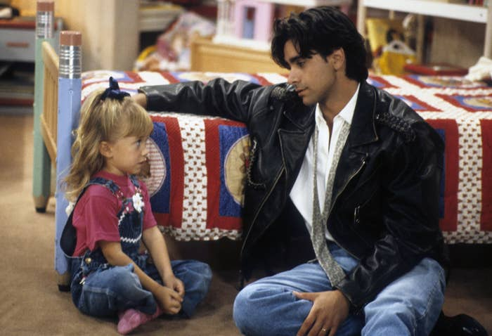 "John and one of the Olsen twins on the ""Full House"" set"