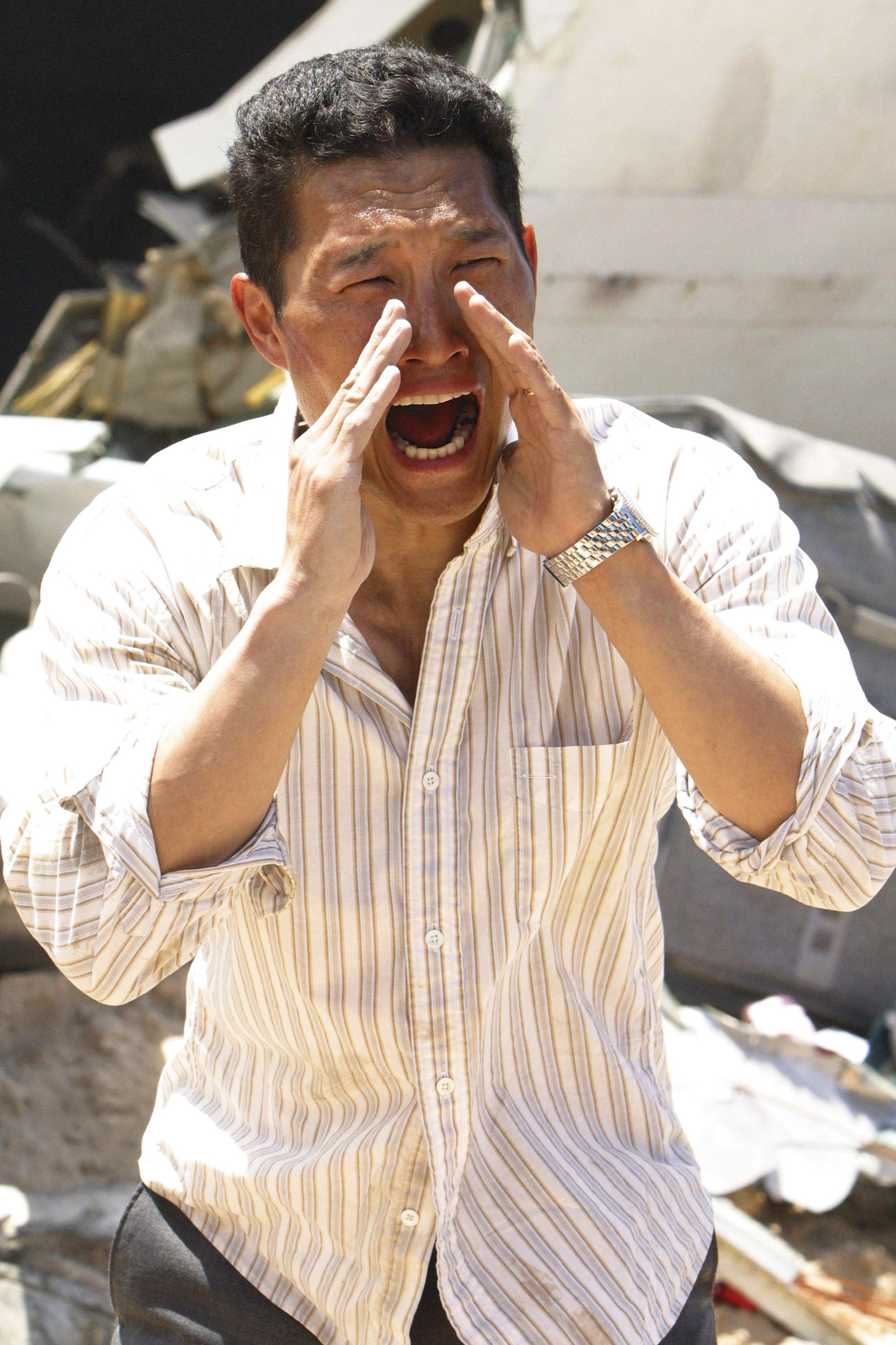 Kim yells with his hands over his hands in the TV show Lost