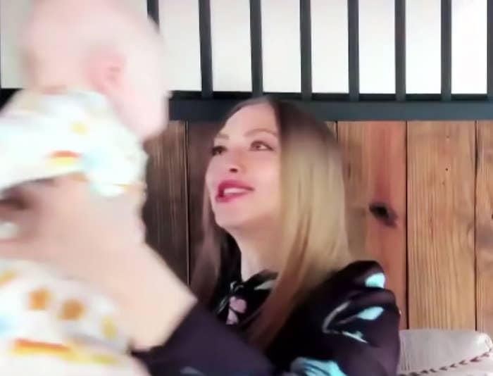 Amanda holding up her son