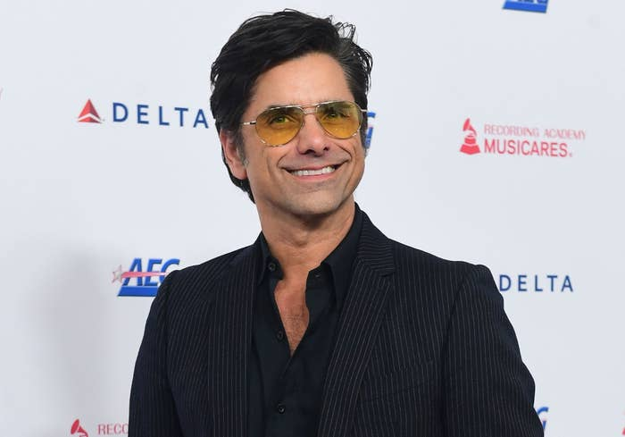 John smiles during a red carpet event