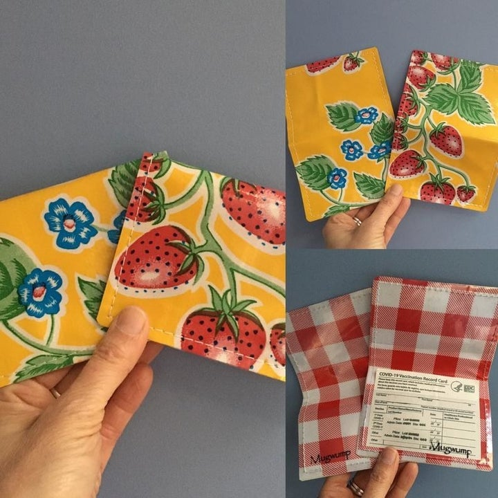 Yellow vaccine card holder with strawberry print on it and red gingham print on the inside