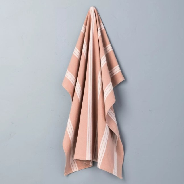 A rose gold flour sack towel that can be used for all your kitchen needs