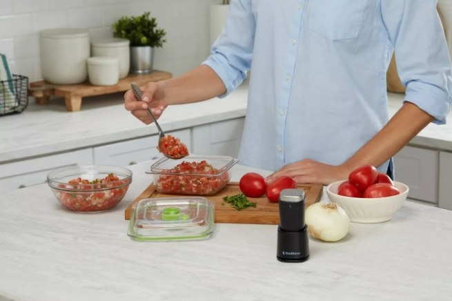 A handheld food sealer vacuum that allows fresh produce, fruit, and meats to stay fresh longer