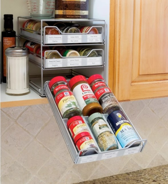 A 3-tier spice rack that can hold up to 18 standard-sized spice containers
