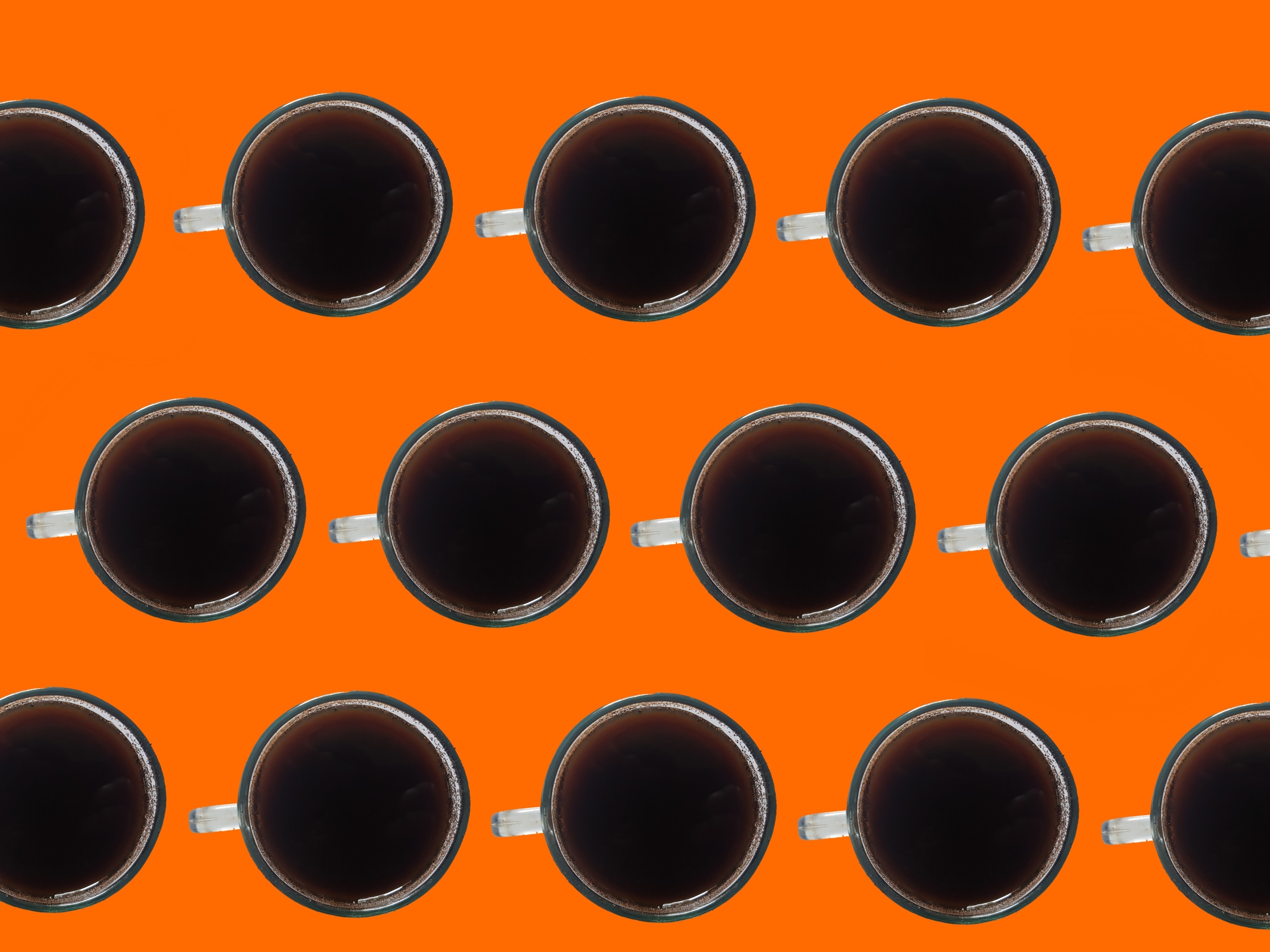 Three rows of espresso shot against a bright yellow background, captured from above.