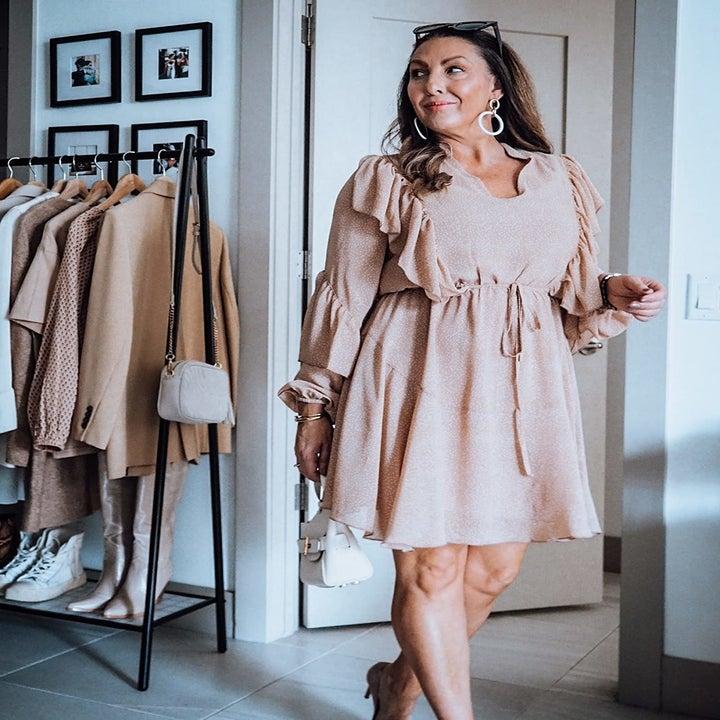 Reviewer wearing brown dress