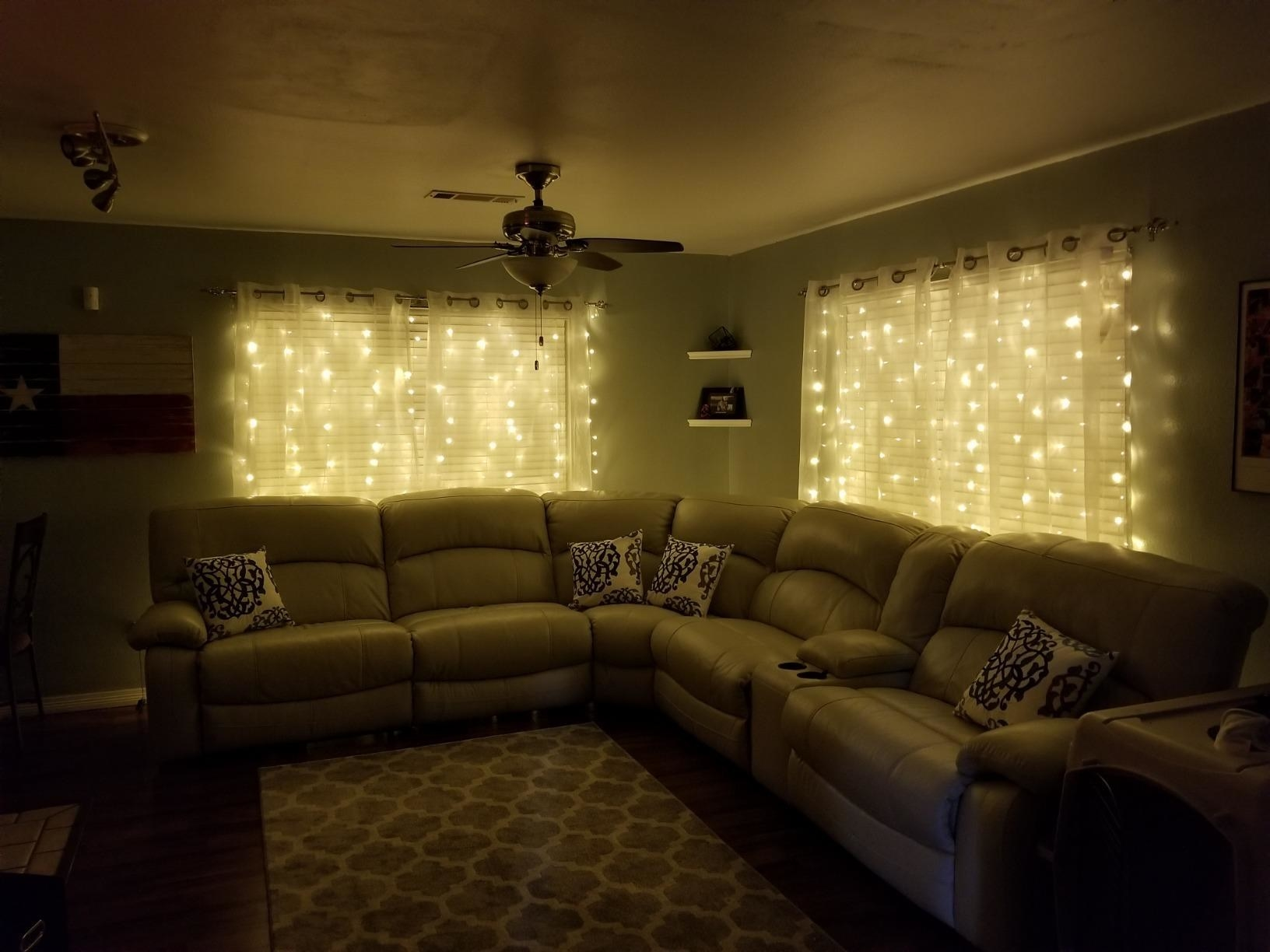 a reviewer's living room with twinkle lights hanging down the windows
