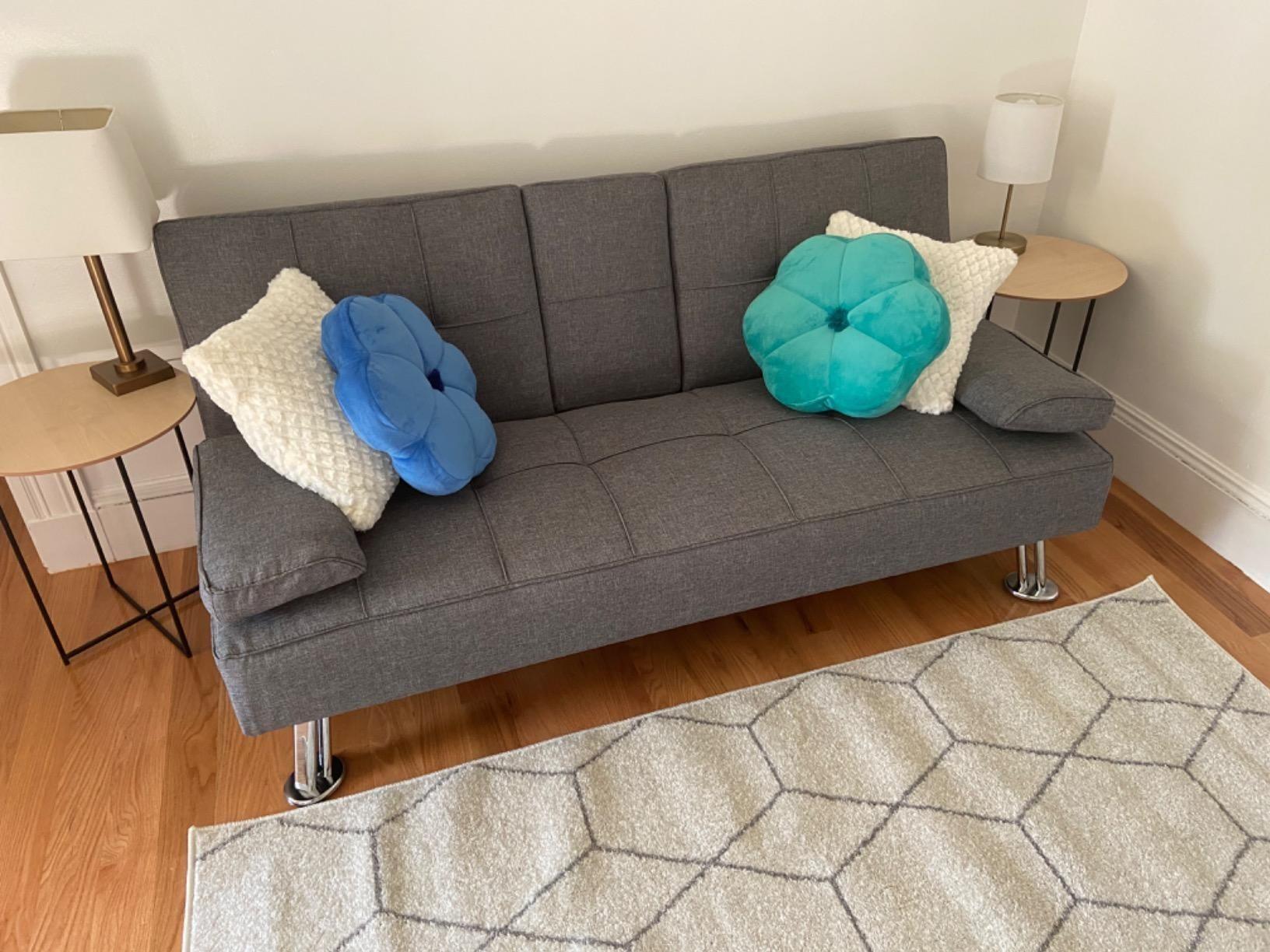 a gray linen tufted futon