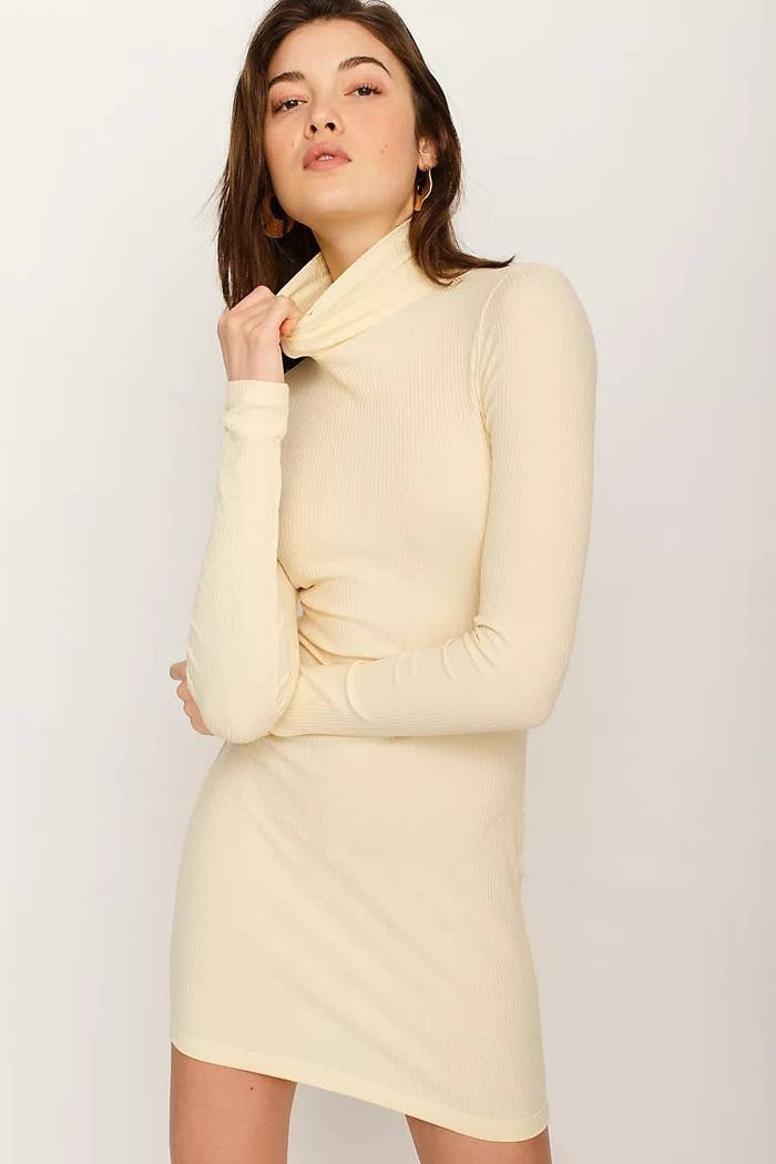 model wearing white turtleneck dress