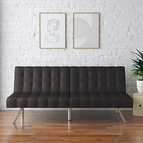 a brown tufted futon with gold legs
