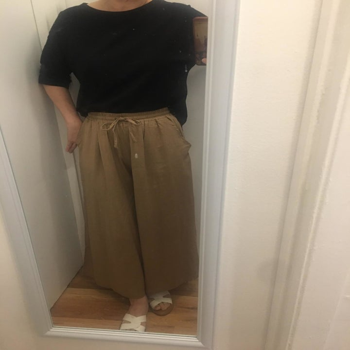 mirror selfie of a reviewer wearing the khaki colored lock and love linen wide leg pants