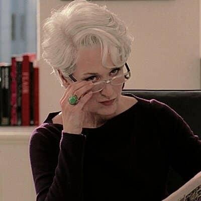 "Miranda Priestly from ""The Devil Wears Prada"" takes off her glasses in curiosity"