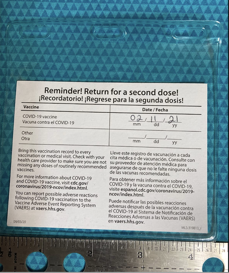 Back of a vaccine card in a vinyl sleeve