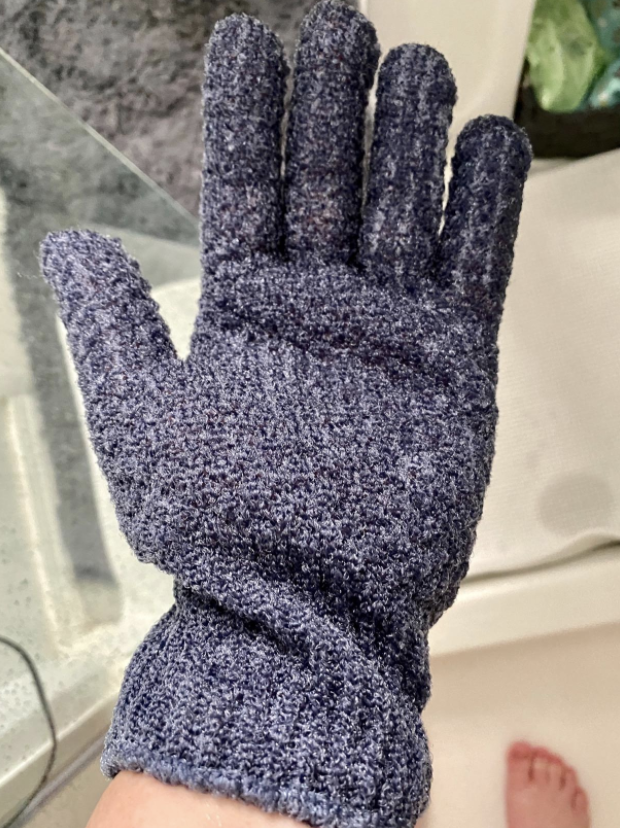 person's hand in glove
