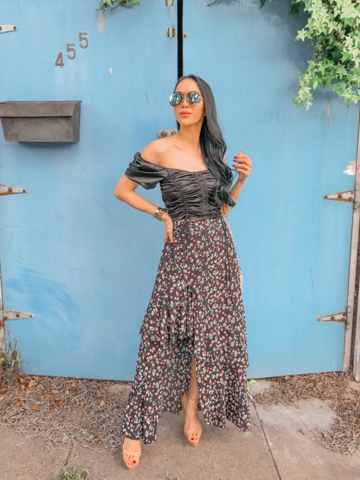 image of reviewer wearing the z-black pattern BTFBM boho floral high low skirt with a black ruched crop top