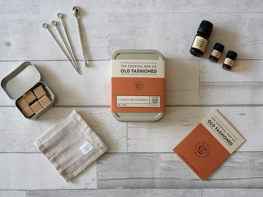 A flatlay of the cocktail kit with all the elements neatly arranged around the box