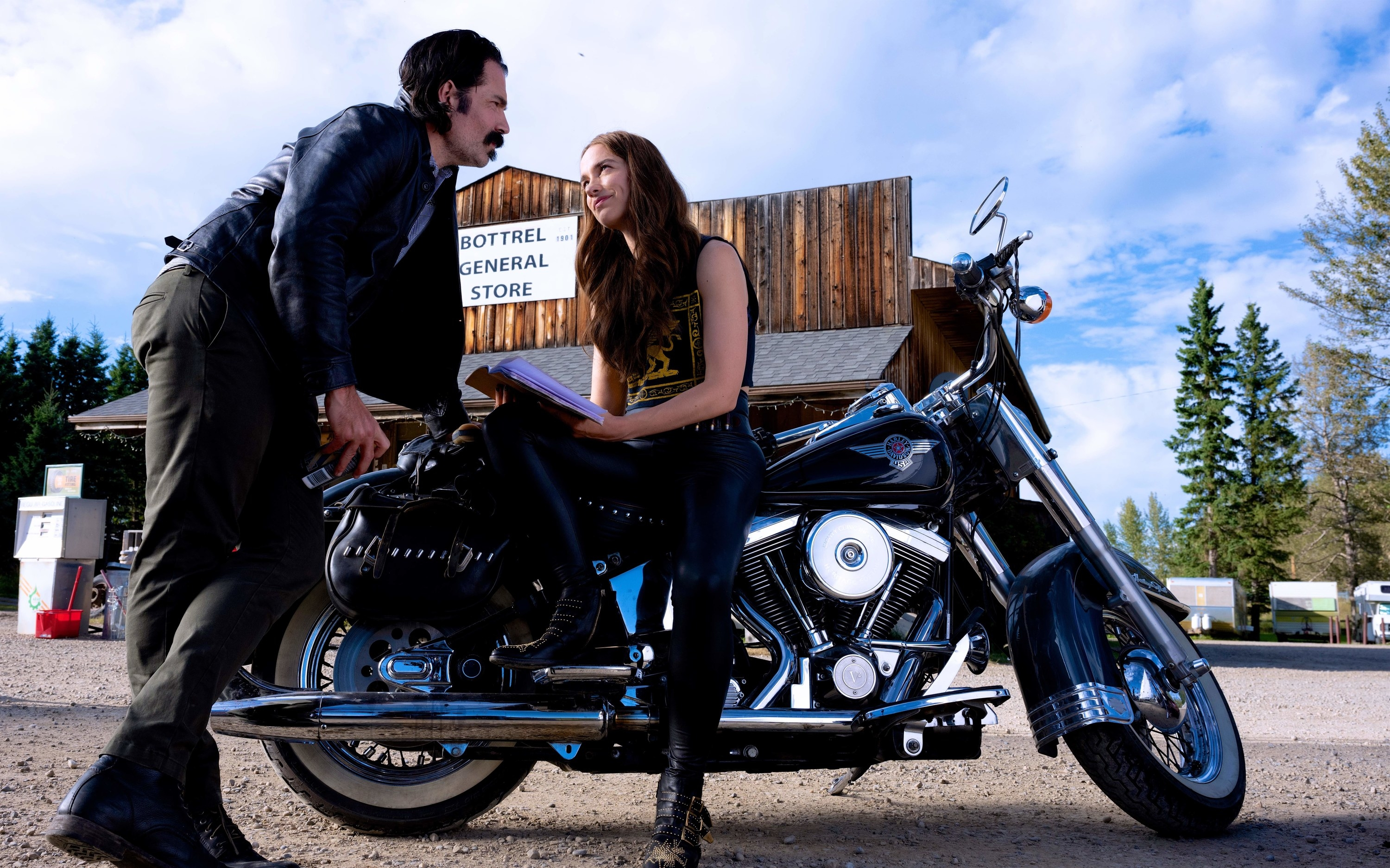Doc and Wynonna talking while Wynonna sits on her motorcycle