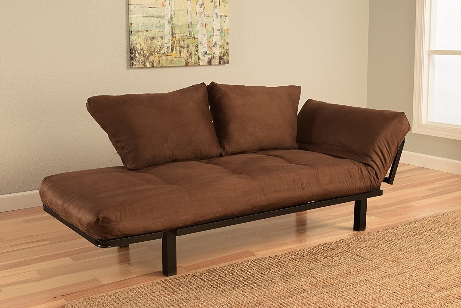 a brown couch that folds up and down along the sides