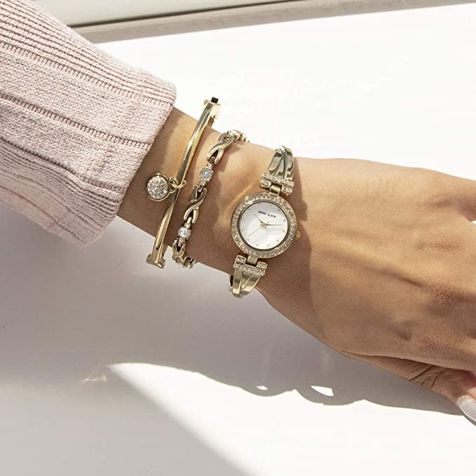 model wearing watch with two matching bracelets