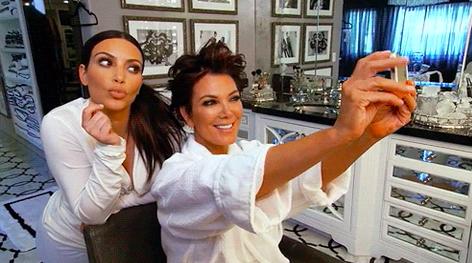 Kris Jenner taking a selfie with Kim Kardashian