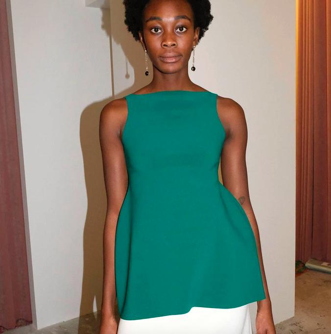 A model wearing the Birrot Janbi top in green