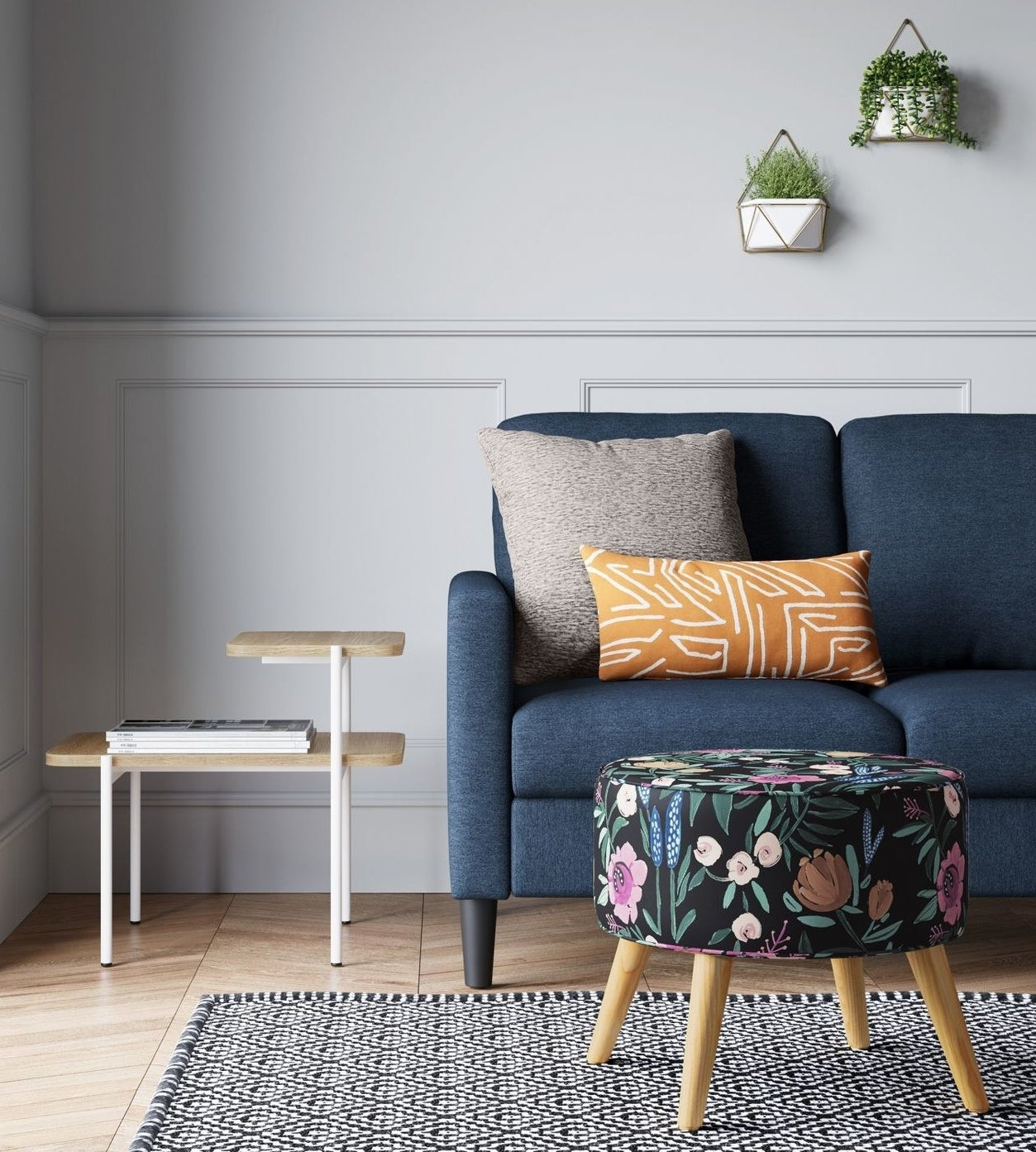 black and floral round ottoman with wood legs