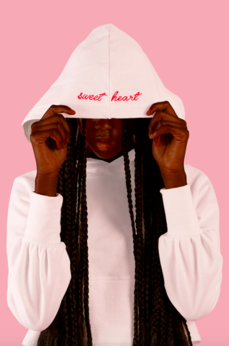 A model pulling the hood of The Sweatheart hoodie over their eyes