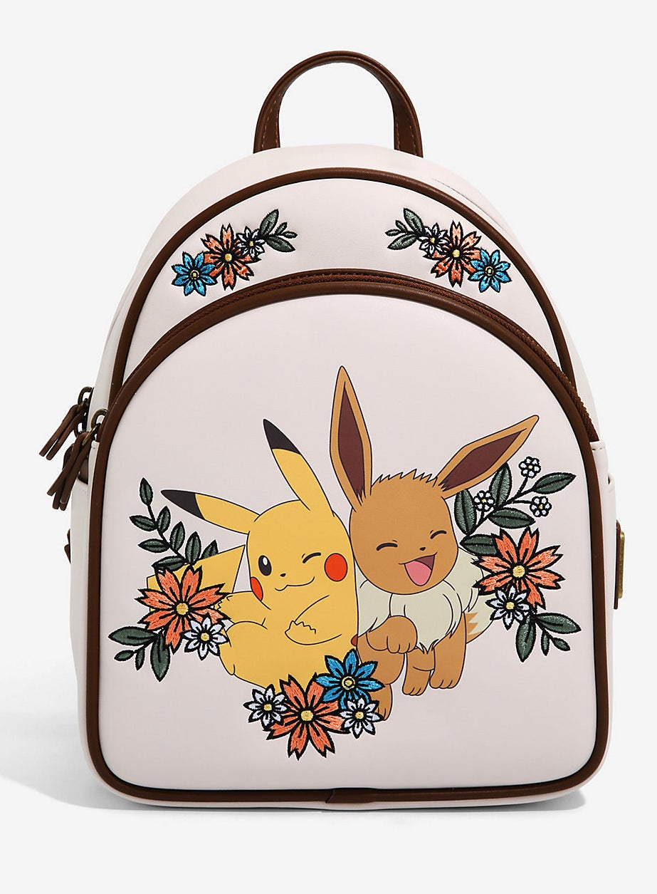 cream and brown trim backpack printed with a large graphic of Pikachu and Eevee surrounded by embroidered flowers